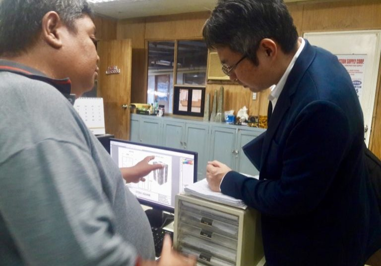 Mr. Rani Abdhuramhan, General Manager, explaining to Mr. Hiroyuki Kanzaki, Team Leader, how they design their products.